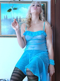 Blonde smoker shows off her funky fashion stripy hose with a green glitter pictures at find-best-panties.com