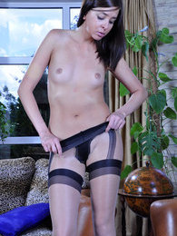 Sexy maid flaunting her long legs in blue and mock FF stocking pantyhose pictures at kilovideos.com