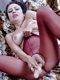 Smiley girl takes a long dildo out of her burgundy sheer-to-waist pantyhose pictures at freekilosex.com