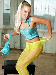 Trendy blonde posing sexy in her smashing neon green lacy pattern tights pictures at relaxxx.net