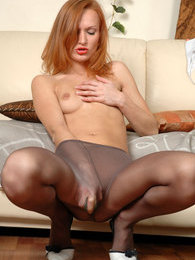 Red-haired cutie licks her silky smooth pantyhosed legs and plugs her pussy pictures