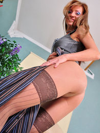 Seductive vixen in mock hold-ups uses a dildo in her pantyhose fetish play pictures at find-best-mature.com