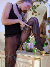 Hot teaser in chic tights with a mock hold-up pattern puts to use a sex toy pictures at find-best-pussy.com