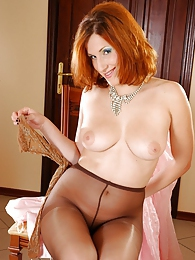 Frisky redhead changes her sheer-to-waist hose for richly patterned tights pictures at freekilosex.com