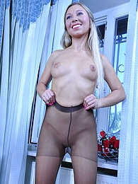 Naughty office girl spots a ladder on her crotchless hose and changes them pictures at lingerie-mania.com