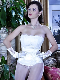 Sexy bride wears her wedding gown with gloves and white back seam pantyhose pictures