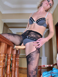 Heated babe rips her flowery pattern pantyhose before some solo dildo play pictures at freekilosex.com