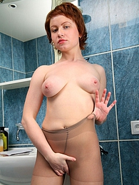 Nude redhead unpacks a new pair of pantyhose getting dirty in the bathroom pictures
