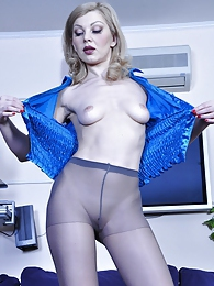 Hot babe strips her office attire admiring the look and feel of grey hose pictures at kilosex.com