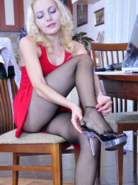 Hot babe changes into her office outfit completed with barely black tights pictures at lingerie-mania.com
