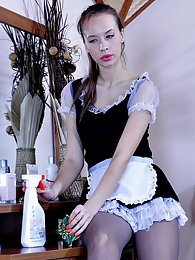 Nasty French maid sneaks a huge fuck toy and slides it into her nyloned box pics