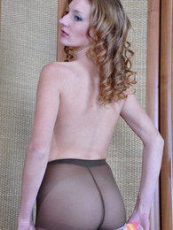 Gorgeous babe smoothens her dark control top tights and changes her dress pictures at dailyadult.info