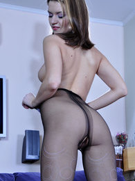 Pretty French maid changes into raunchy open crotch tights with a pattern pictures at adspics.com