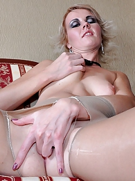 Pantyhose-loving babe fingering her pussy hole thru ripped to shreds tights pictures at freekiloporn.com