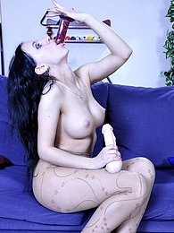 Sultry hottie stuffing her pussy right thru her crotchless patterned hose pictures at find-best-tits.com