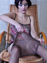 Bobbed brunette fitting her smooth control top pantyhose on her long legs pictures at lingerie-mania.com