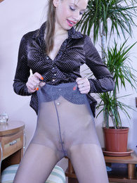 Awesome chick gets ready for a working day after putting on her grey hose pictures at find-best-ass.com