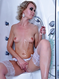 Hot-assed chick takes a shower and wets her white lacy gartered stockings pics