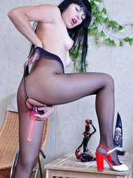 Sultry brunette shoving a huge dildo thru her black open crotch pantyhose pictures at freekiloporn.com