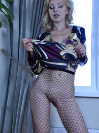 Glamour blonde makes a strip show revealing her black fishnet pantyhose pictures