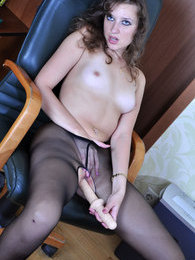 Naughty sec starts ramming a dildo thru her crotchless hose right at work pictures at sgirls.net