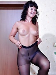Foxy brunette changes into her bright attire with gorgeous black pantyhose pictures at find-best-panties.com