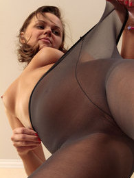 Frisky upskirt girl pulls her dark stretchy pantyhose up to her perky tits pictures