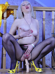 Smashing blonde in a satin outfit rams a toy thru black open crotch tights pictures at adspics.com