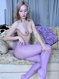 Lovely babe getting fascinated by the look of her lilac and grey pantyhose pictures at freekiloporn.com