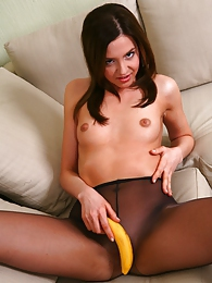 Long-legged vixen in spike heels slides a banana into her control top hose pictures