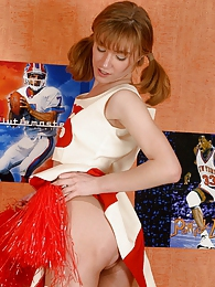Pony-tailed cheerleader ripping her silky pantyhose while dildoing her muff pics
