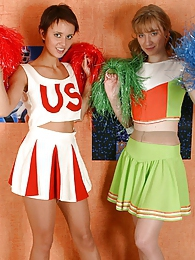 Sporty cheerleaders pleasing each other without taking off their pantyhose pictures at freekiloclips.com