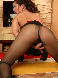 Maid in sexy black pantyhose dusting her yummy tits while tidying up room pictures