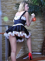 Super hot maid in sheer tights and red fuck-me-pumps going for a cock-ride pictures at freekilosex.com