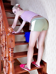 Blond housewife teases her hubby with a downtrousers view for pantyhose sex pictures at lingerie-mania.com