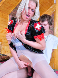 Sassy girl putting on her PVC nurse uniform and white pantyhose for a bang pictures at sgirls.net