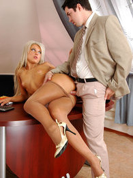 Secretary in shiny tights revealing her fucking skills in front of her boss pictures at freekilosex.com