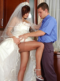 Lusty bride in lace trimmed dress and silky tights going for wild coupling pictures at kilogirls.com
