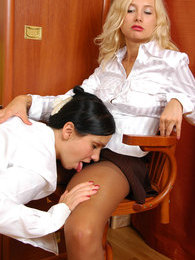 Lesbian secretary seducing her female co-worker into steamy pantyhose sex pictures at freekilomovies.com