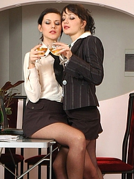Naughty secretary babes in silky tights drinking wine before messing around pictures at freekilosex.com