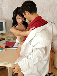 Raunchy pantyhosed secretary posing on the table in front of her horny boss pictures at freekilomovies.com