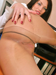 Awesome secretary in silky pantyhose eagerly showing what's under her skirt pictures