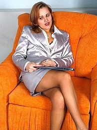 Insatiable secretary eagerly sucking strap-on encased in suntan pantyhose pictures