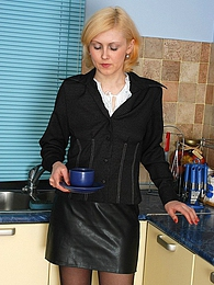 Raunchy secretary in black tights craving for nylon sex during lunch break pictures at freekilomovies.com