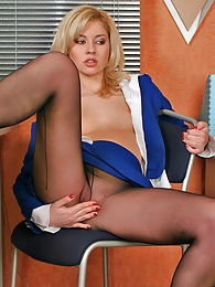 Seductive secretary in luxury pantyhose savoring the taste of sheer nylon pictures at freekilosex.com
