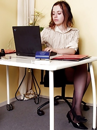 Sexy secretary pulling down her black tights and getting fucked from behind pictures at kilogirls.com