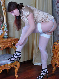 Pigtailed girl changes her silky robe for daywear and cute white stockings pictures at kilogirls.com