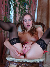 Tempting hottie in black lacy stockings and fuck-me-heels having solo anal pictures at kilotop.com