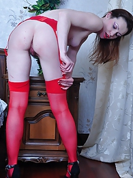 Brightly dressed girl spread-eagles in her red nylons for hot dildo fucking pictures at freekiloporn.com