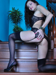 Slim leggy brunette in a black bustier with matching nylons on the stairs pictures at kilosex.com